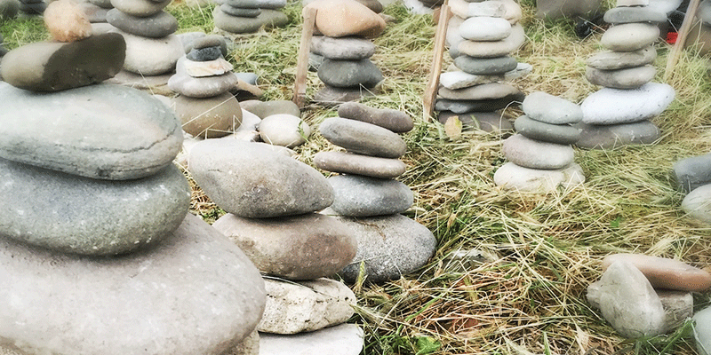 Stacked stones as a metaphor for shifting and sifting birth stories. Photo copyright 2016 Virginia Bobro